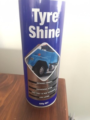 Removing Silicone Tyre Shine from Scooter Tires - spray can of product