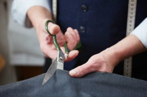 Cutting fabric with fabric scissors.