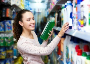A woman shopping for cleaning products.