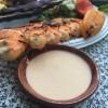 Creamy Seafood Dipping Sauce in bowl with plate of shrimp