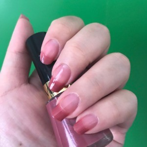 Nails manicured with French tips in a berry color.
