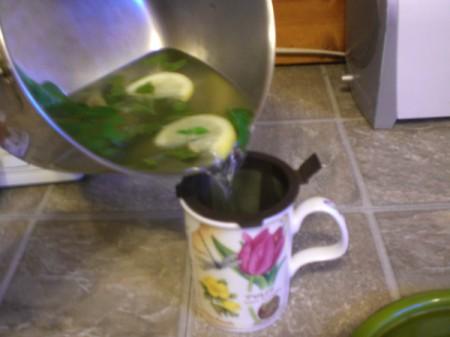 straining spearmint tea
