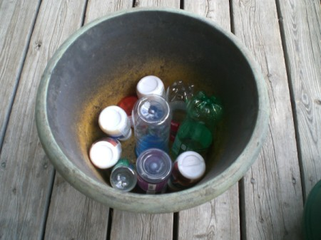 Place Empty Bottles in Garden Pot - planter with plastic bottles in bottom