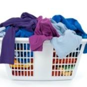 A laundry basket full of clothing.