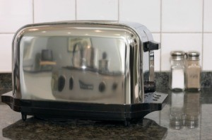 A clean stainless steel toaster.