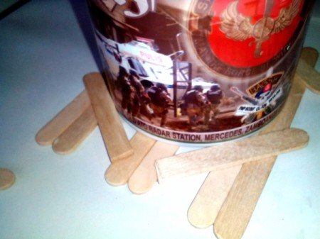 Mug Holder with Goody Compartment - Arrange cut halves of Popsicle sticks around the mug.  Glue into place.