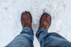 A pair of shoes in snowy weather.