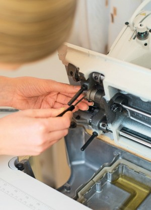 A sewing machine being repaired.