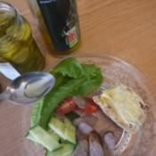 Pickle Jar vinegar spooned onto plate of veggies