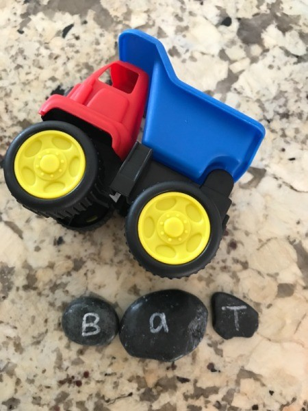 "Alphabet Rocks - dump truck and rocks spelling out ""bat"""