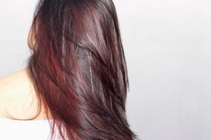 A brunette with red highlights.