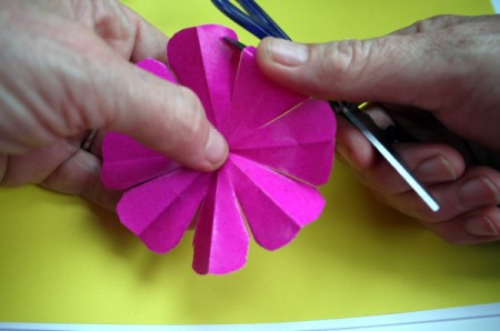 Paper Flower Decorations - curl the ends of the petals with your scissors