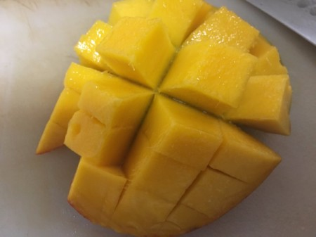 sliced mango still attached to skin