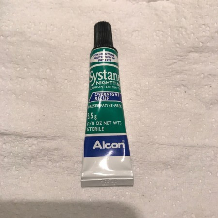 A tube of Systane eye lubricant.