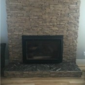 Modernizing a Brick Fireplace - light tan irregular stone/brick fireplace