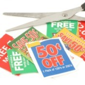 Several coupons and a pair of scissors.