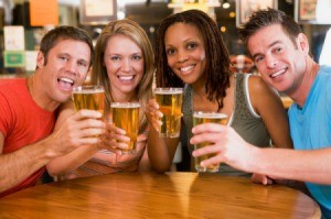 A group of friends drinking at a bar.
