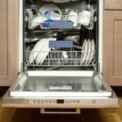 A dishwasher with the door open.