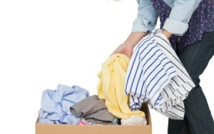 Pulling stored clothing out of a box.