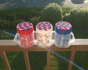Recycled Decorative Candy Jars - finished jars sitting in a cookie tray on the balcony rail