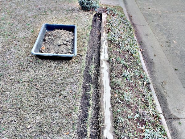 Sunken Gutters For Flower Border Containers - trench where gutter has been lifted