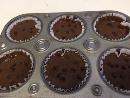 filled muffin tins with chocolate chips
