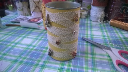 Tin Can Organizers - sparkly paper, lace, and jewelry on this one