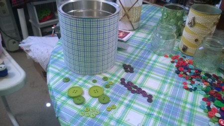 Tin Can Organizers - paper wrapped coffee can with green and purple buttons lying next to it