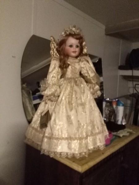 Value of Seymour Mann Porcelain Doll - angel doll