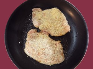 Pork chops dredged in panko breadcrumbs.