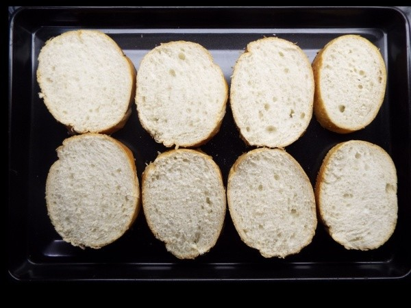 Eight slices of French bread.