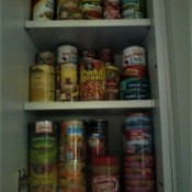 A pantry full of cans of food.