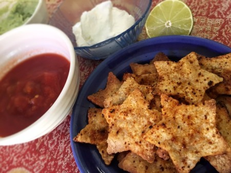 star tortilla chips in bowl with salsa and sour cream