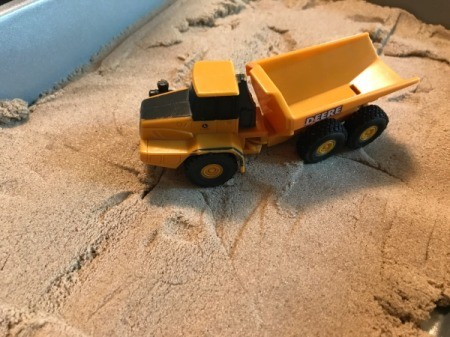 Lidded Cake Pan for Kinetic Sand - dump truck toy on sand
