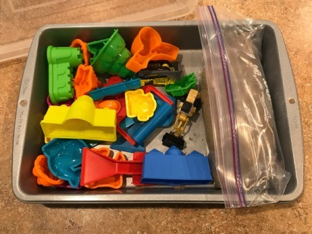 Lidded Cake Pan for Kinetic Sand - sand in a zipper bag with molds and toy machines