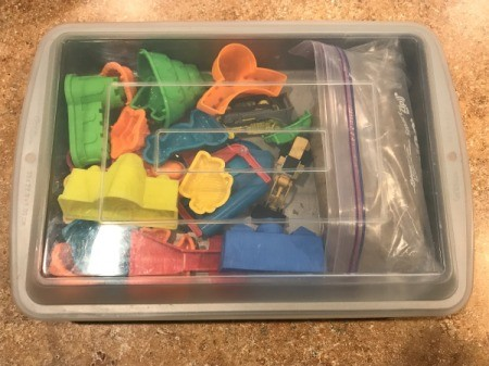 Lidded Cake Pan for Kinetic Sand - closed pan with toys and sand inside