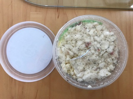 feta cheese in container
