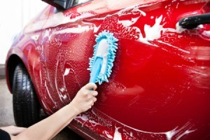 Cleaning a car door.