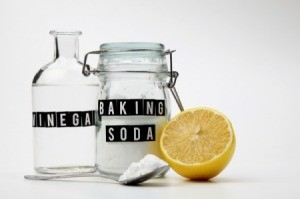 A jar of baking soda and a bottle of vinegar.