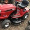 Red Craftsman riding mower.