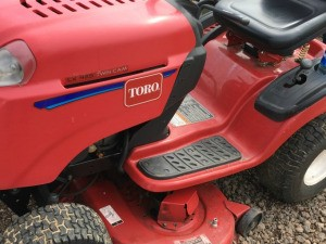 A red Toro riding mower.
