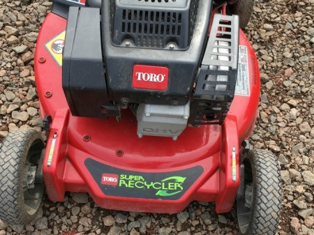 A toro grass recycler mower.