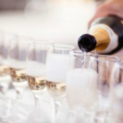 Serving champagne at a wedding reception.