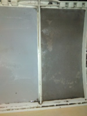 Keep Dryer Lint Trap Clean - clean and dirty side of dryer lint trap