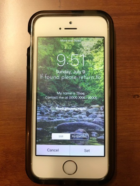 An iPhone with contact information displayed on the lock screen.