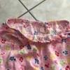 Feeding elastic through the waist of a pair of pajama pants.