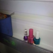 Bottles of nail polish stored in the refrigerator.
