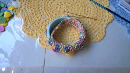 Crochet Covered Bangle - continue stitching around and then readjust to have buttons on top