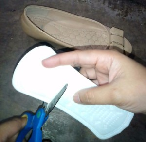 Preventing Pain from Blisters with a Pantyliner - cutting a small piece from a panty liner