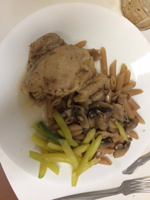 Chicken Marsala on plate with pasta and beans